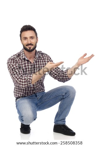 Cheerful man gesturing with his hands, white background - stock photo