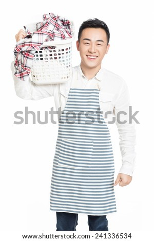 cheerful man holding a laundry basket isolated on white background - stock photo