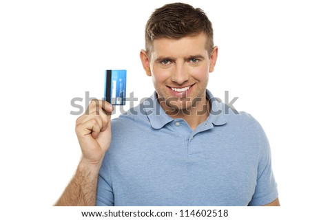 Cheerful man holding credit card. Closeup shot - stock photo