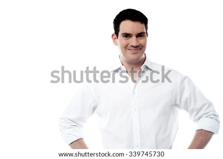 Cheerful man posing over white