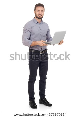 Cheerful man with a laptop - stock photo