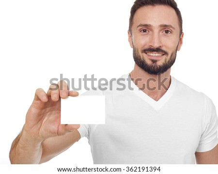 Cheerful man with business card - stock photo
