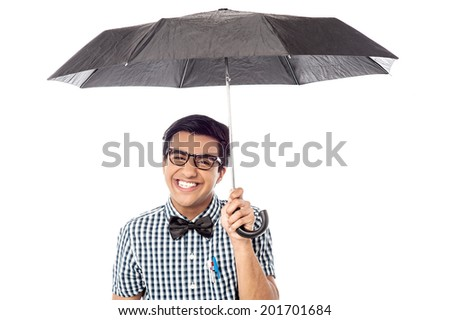 Cheerful man with opened umbrella, isolated on white - stock photo
