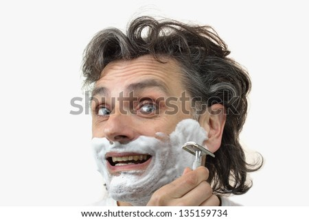 cheerful man with shaving cream over white