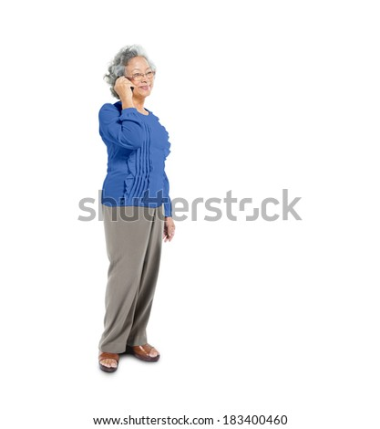 Cheerful Mature Asian Woman Using her Mobile Phone - stock photo