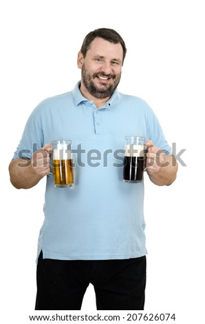 Cheerful mature bearded man likes to drink blend of a light beer with a dark porter - stock photo