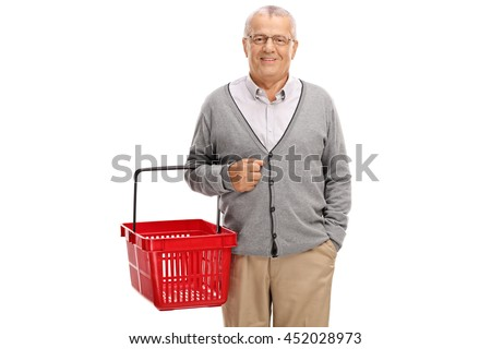 Cheerful mature man holding an empty shopping basket isolated on white background