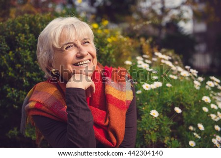 Cheerful mature woman laughing and showing happiness
