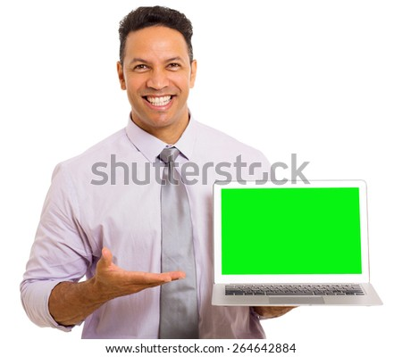cheerful mid age businessman presenting laptop computer on white background - stock photo