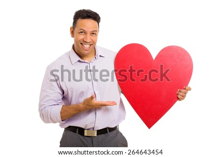 cheerful mid age man presenting red heart shape on white background - stock photo