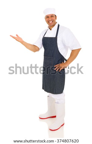 cheerful middle aged chef presenting empty space on white background - stock photo