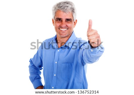 cheerful middle aged man giving thumb up on white background - stock photo