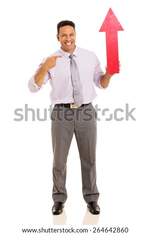 cheerful middle aged man holding red arrow pointing up - stock photo