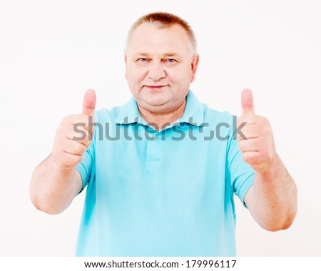 Cheerful middle aged man in blue shirt showing thumb up gesture by two hands over white background
