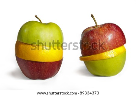 Cheerful mixed up Fruits with an apple and organge - stock photo
