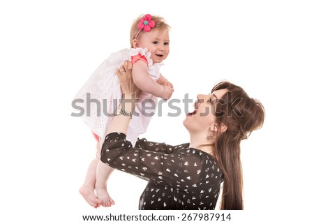 Cheerful mother playing with her little baby girl isolated on white background