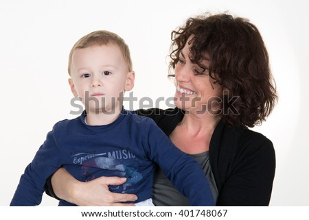 Cheerful mother with her son in her arms isolated