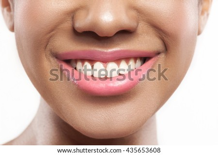 Cheerful mulatto girl is satisfied with her appearance - stock photo