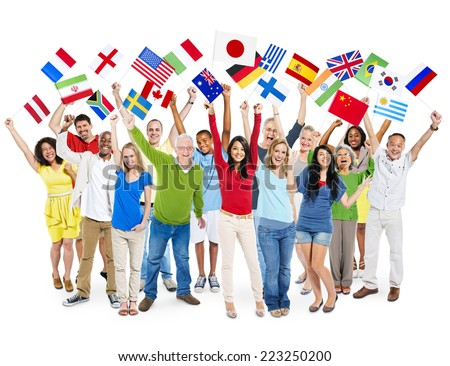 Cheerful Multi-Ethnic Group Of People Standing With Their Arms Raised Holding World Flags. - stock photo