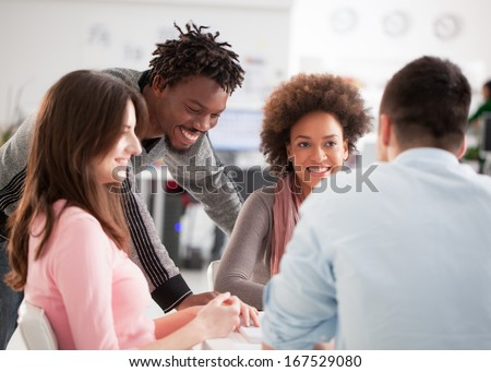 Cheerful multiethnic group of college students studying together. - stock photo