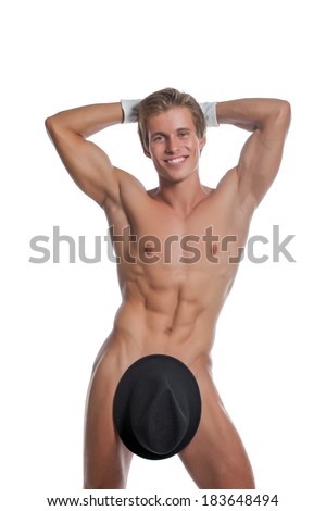 Cheerful naked man posing with hat and gloves - stock photo