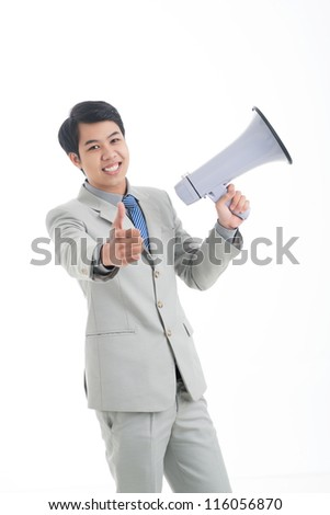 Cheerful office guy with megaphone holding his thumb up - stock photo