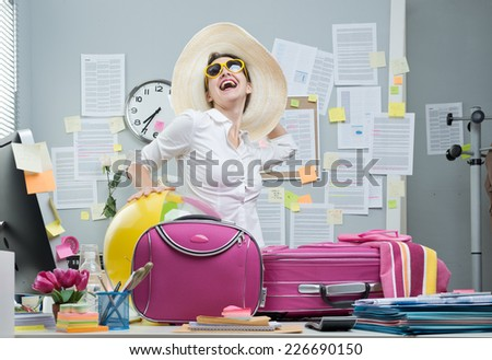 Cheerful office worker with pink luggage and sunglasses ready for vacations. - stock photo