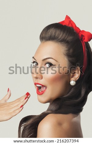 Cheerful pin-up girl portrait - stock photo