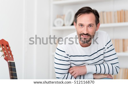 Cheerful positive man looking at you