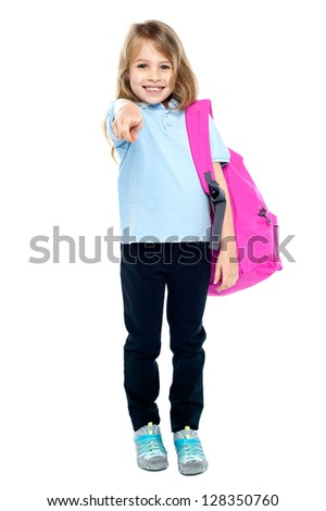 Cheerful pretty kid pointing towards you. Isolated over white. - stock photo