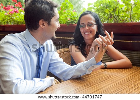 Cheerful pretty lovers at restaurant table