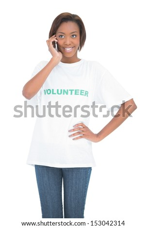 Cheerful pretty volunteer having a phone call on white background - stock photo