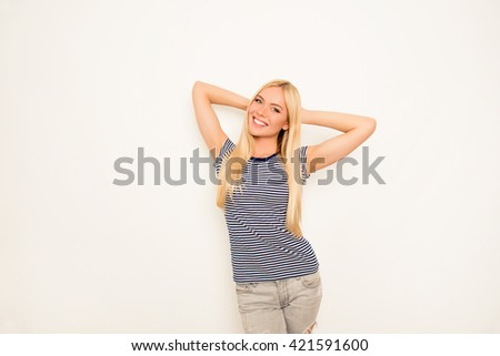 Cheerful pretty young woman dreaming on white background - stock photo
