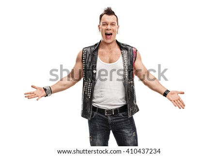 Cheerful punk rocker in an old jacket with pins and badges gesturing with his hands isolated on white background - stock photo