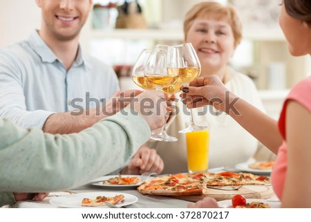 Cheerful relatives are dining together with joy