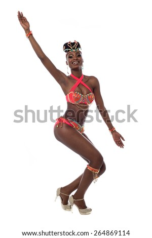 Cheerful samba woman dancer posing over white - stock photo