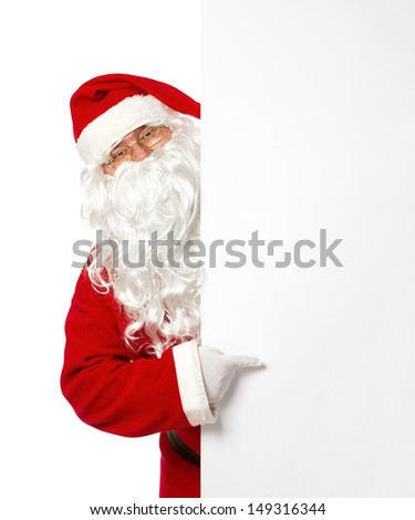 Cheerful Santa Claus pointing on a blank advertisement banner isolated on white background - stock photo