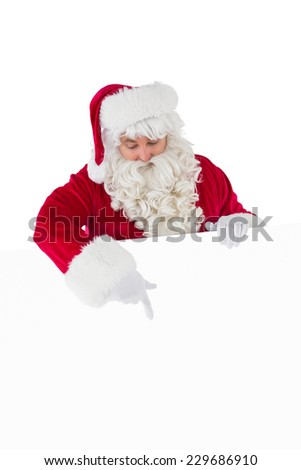 Cheerful santa claus presenting sign on white background - stock photo