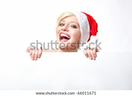 Cheerful santa woman holding empty white board - stock photo