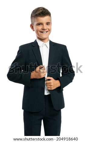 cheerful schoolboy corrects jacket isolated
