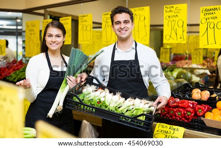 Cheerful sellers offering good price for vegetables and fruits
