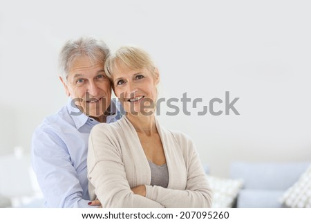 Cheerful senior couple embracing each other - stock photo