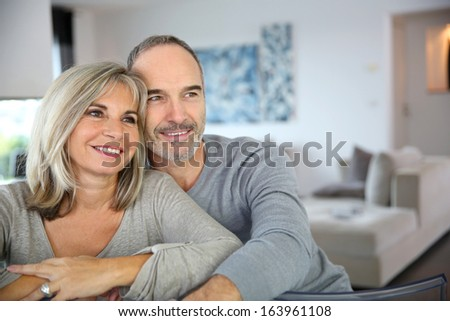 Cheerful senior couple enjoying life - stock photo