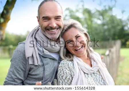 Cheerful senior couple enjoying peaceful nature - stock photo