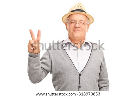 Cheerful senior man gesturing peace sign with his hand and looking at the camera isolated on white background