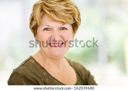 cheerful senior woman closeup portrait at home - stock photo
