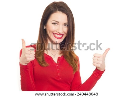 cheerful sexy woman in red shows thumbs up with two hands - stock photo