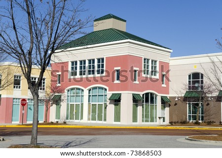 Cheerful shopping strip mall architecture - stock photo