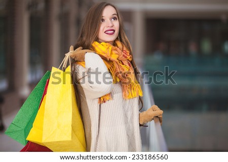 Cheerful shopping Woman holding bags - stock photo