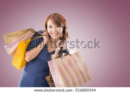 Cheerful shopping woman of Asian holding bags. - stock photo